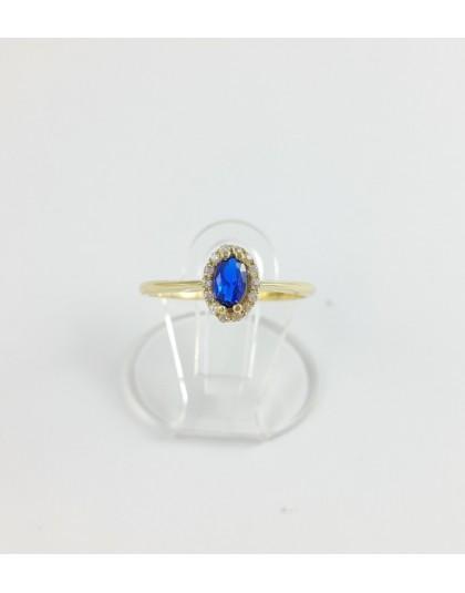 Złoty pierścionek z granatową owalną cyrkonią r 15