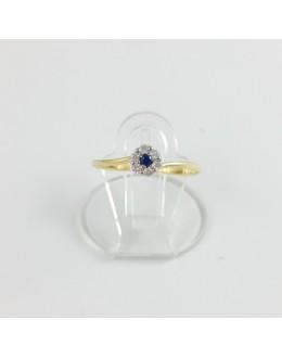 Złoty pierścionek kwiatek z granatową cyrkonią r 12